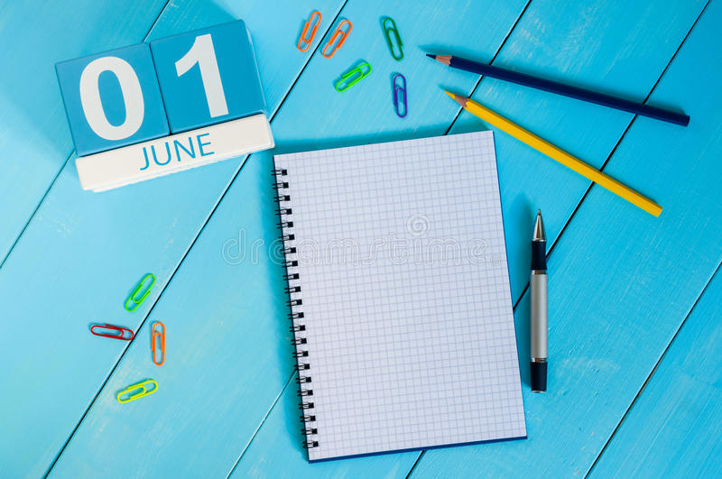 June 1st. Image of june 1 wooden color calendar on blue background. First summer day. Empty space for text. Happy Childrens Day royalty free stock image