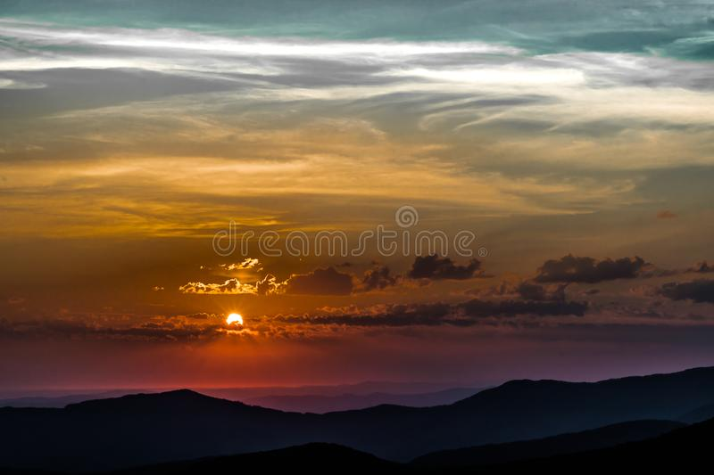 June sunrise. Beautiful early june sunrise in the mountains stock photos