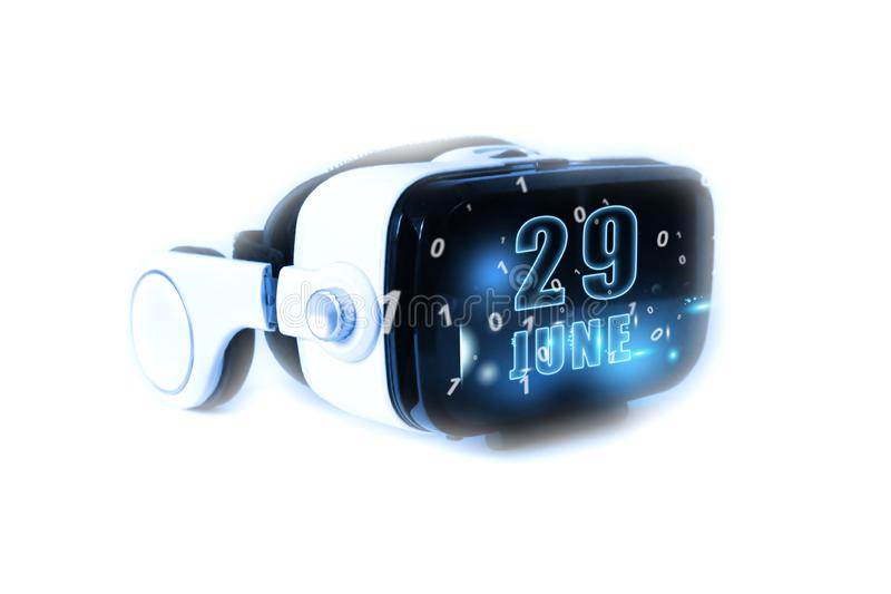 June 29th. Day 29 of month,calendar date month and day glows on virtual reality helmet or VR glasses. Virtual technologies, future. June 29th. Day 29 of month stock photography