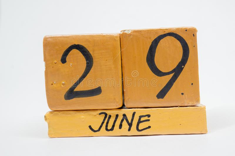 June 29th. Day 29 of month, handmade wood calendar isolated on white background. summer month, day of the year concept. June 29th. Day 29 of month, handmade wood royalty free stock photography