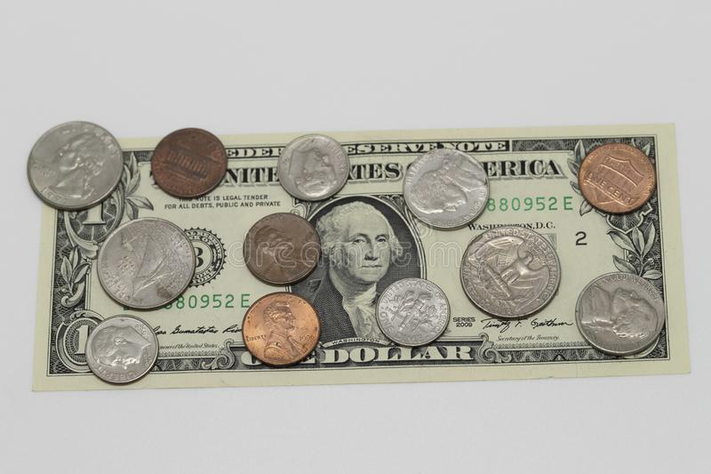 US dollar currency. June 25, 2019, Tokyo, Japan - A picture of an US dollar bill and coins royalty free stock photography