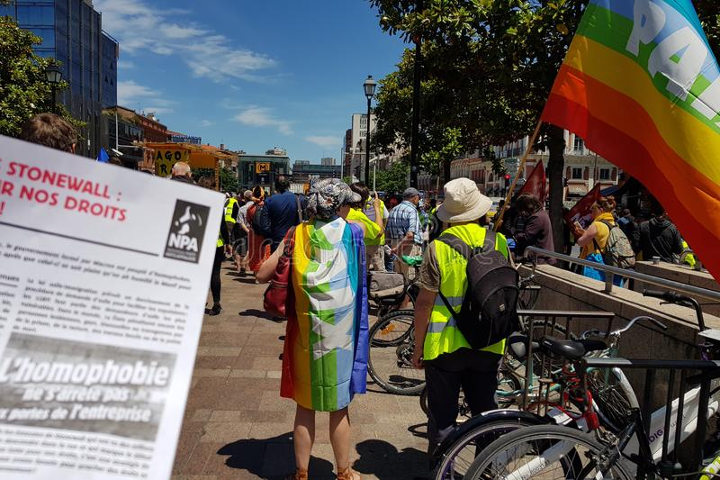 Mouvement of Yellow vests support Pride March. French anti-homophobia leaflet stock photos