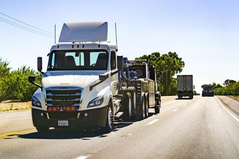 June 26, 2019 Tracy / CA / USA - Truck towing another truck stock photos