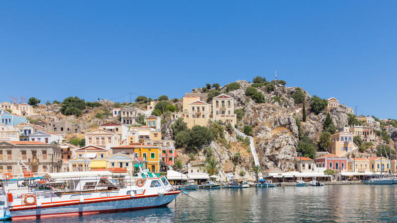22 JUNE 2017. View of the bay at Symi, Greece. 22 JUNE 2017. View of the bay at Symi island, Greece royalty free stock images