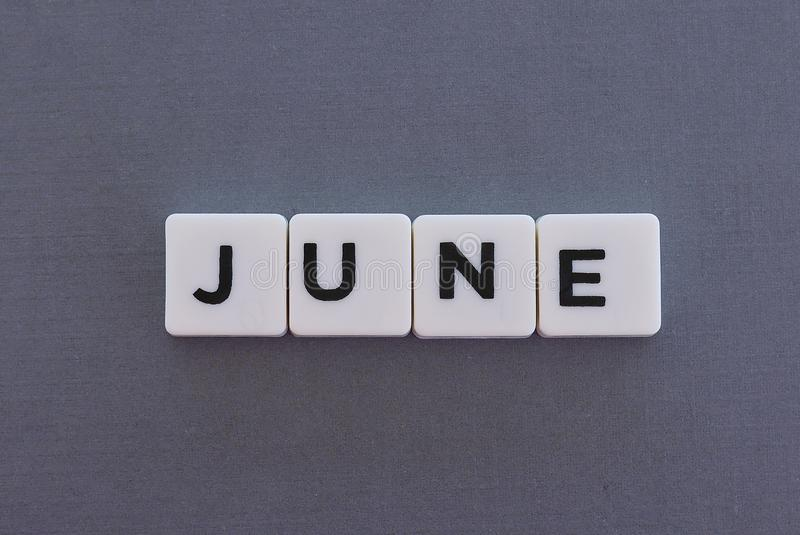 June word made of square letter word on grey background. Month time day date monthly calendar concept text summer reminder design number hello diary holiday stock photo