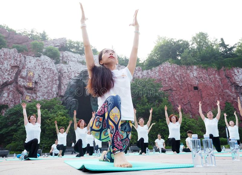 Huaian, jiangsu: two days of summer solstice yoga and a day of worship by yoga lovers advocate healthy life royalty free stock photo