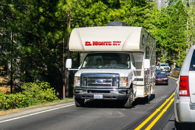 June 26, 2019 Yosemite National Park / CA / USA - El Monte RV travelling on Highway 120 on a sunny summer day; El Monte RV offers. Rental and maintenance stock image