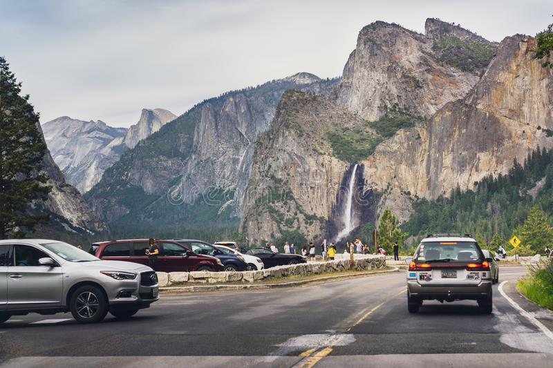 June 27, 2019 Yosemite National Park / CA / USA - Tourists gathered at the Tunnel View vista point; Bridalveil Fall and Half Dome stock photos