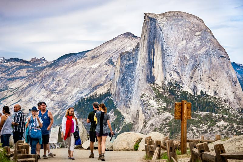 June 27, 2019 Yosemite National Park / CA / USA - Unidentified people visiting Glacier Point; Half Dome visible in the background stock image