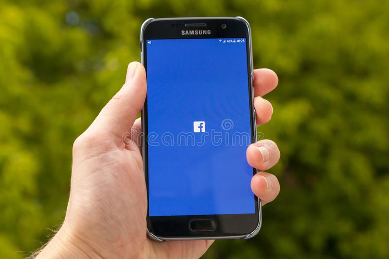 Facebook on smartphone. June 28, 2018 Zagreb, Croatia, Longing on mobile app Facebook on Samsung smartphone. Facebook is an American online social media and stock photos