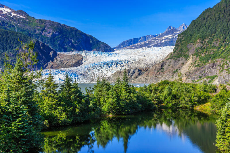 Juneau, Alaska. Mendenhall Glacier. Viewpoint with reflection in the lake royalty free stock photography