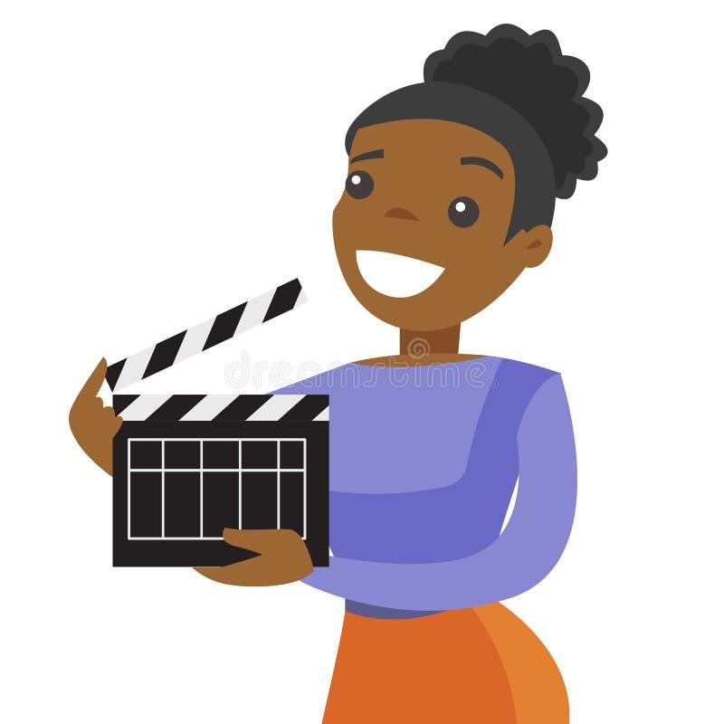 Junge afrikanische Frau, die ein Filmscharnierventilbrett hält lizenzfreie abbildung