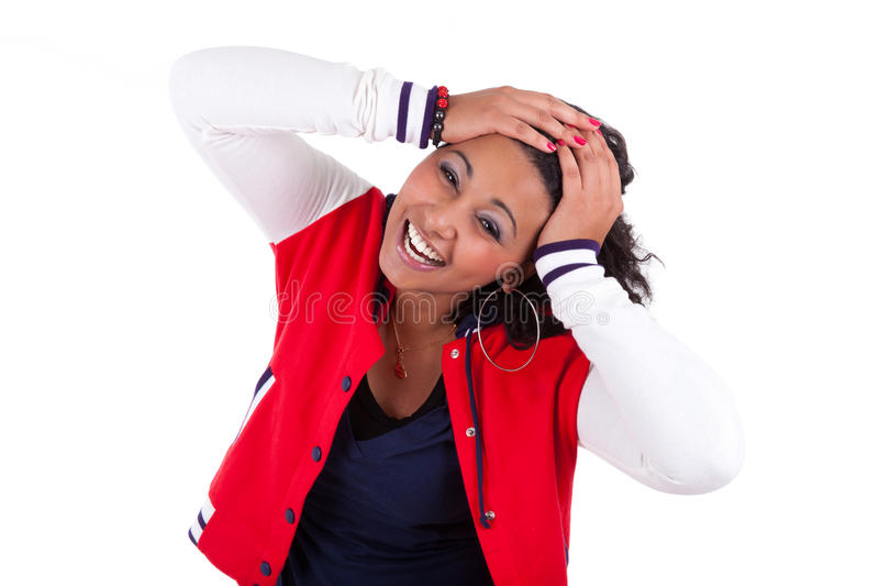 Junge Afroamerikanerfrauenholding ihr Kopf stockfoto