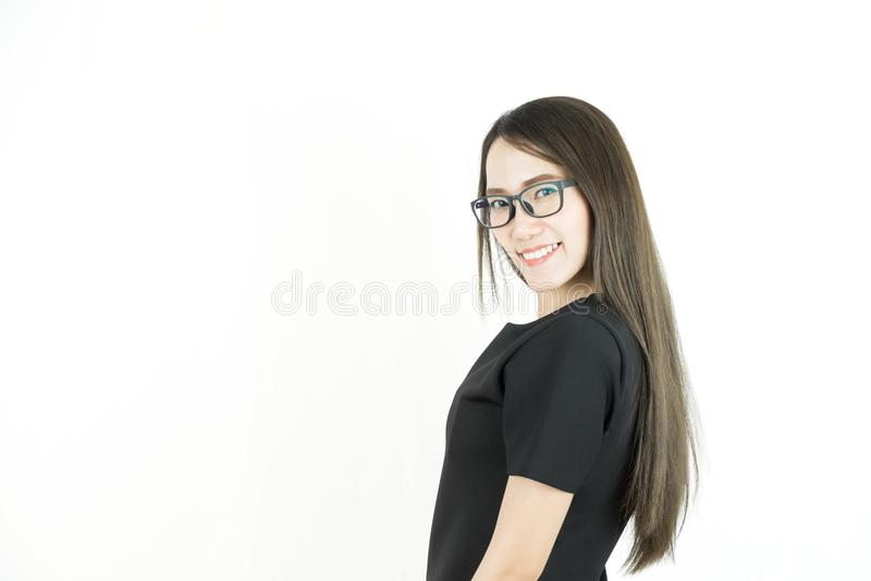 Junge Asiatin mit tragenden Gläsern des smileygesichtes stockfotos