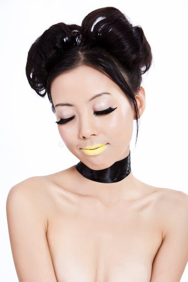 Junge asiatische Frau mit kreativer bunter Verfassung stockfotografie
