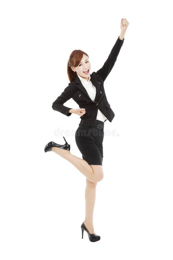Junge asiatische Geschäftsfrau mit Erfolgsgeste stockbild