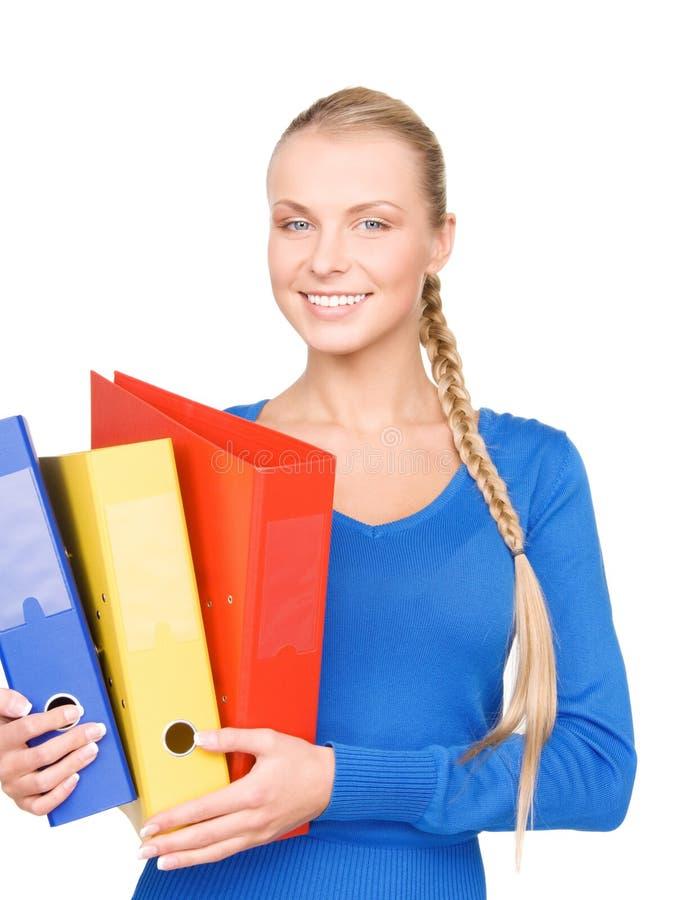 Junge attraktive Geschäftsfrau mit Ordnern lizenzfreies stockbild