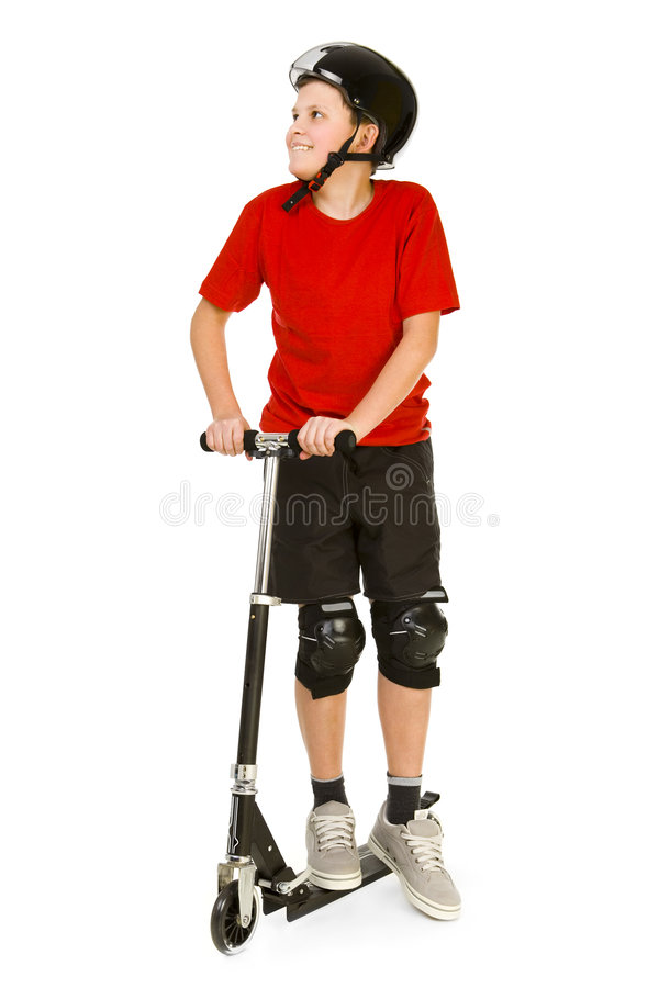 Junge auf dem skooter lizenzfreie stockfotos