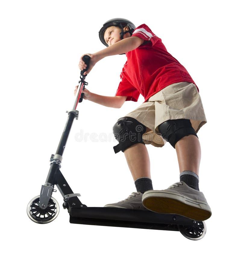 Junge auf Roller stockfotografie