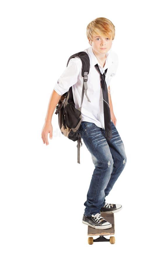 Junge auf Skateboard stockbild