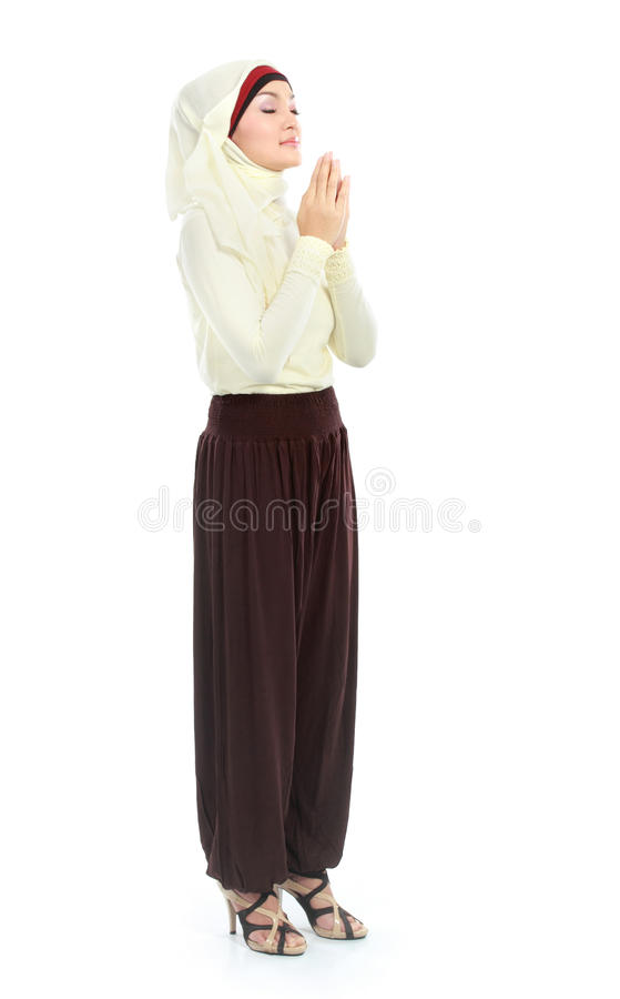 Junge betende Frau lizenzfreie stockfotos