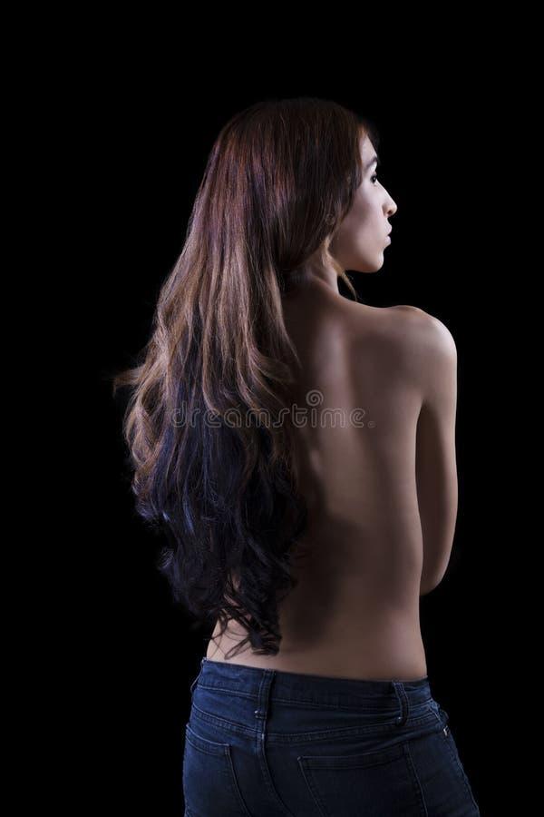 Junge dünne hispanische Frauen-bloße hintere Jeans stockbilder