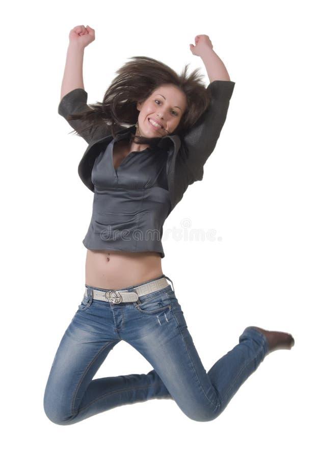 Junge Dame in einem Sprung lizenzfreies stockbild