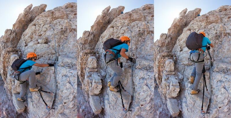 Junge, der a über ferrata in den italienischen Dolomit klettert. lizenzfreies stockbild