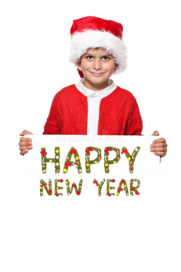 Junge, der ein Weihnachtsplakat anhält lizenzfreies stockfoto