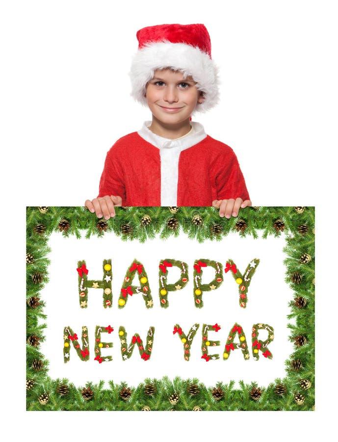 Junge, der ein Weihnachtsplakat anhält stockbild