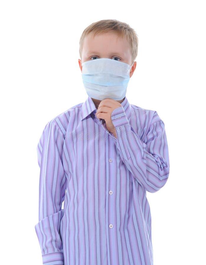 Junge in der medizinischen Schablone stockfoto