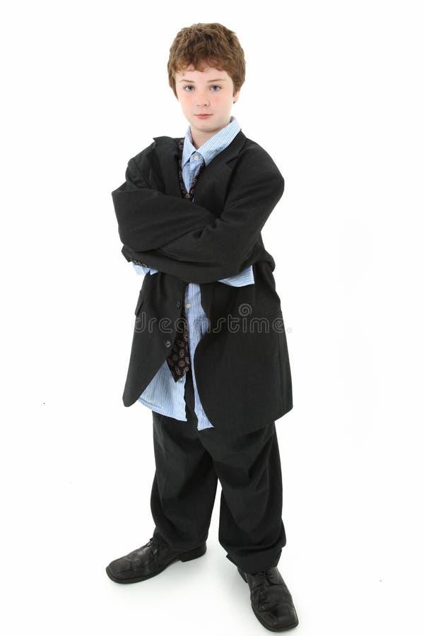 Junge in der sackartigen Klage lizenzfreies stockfoto