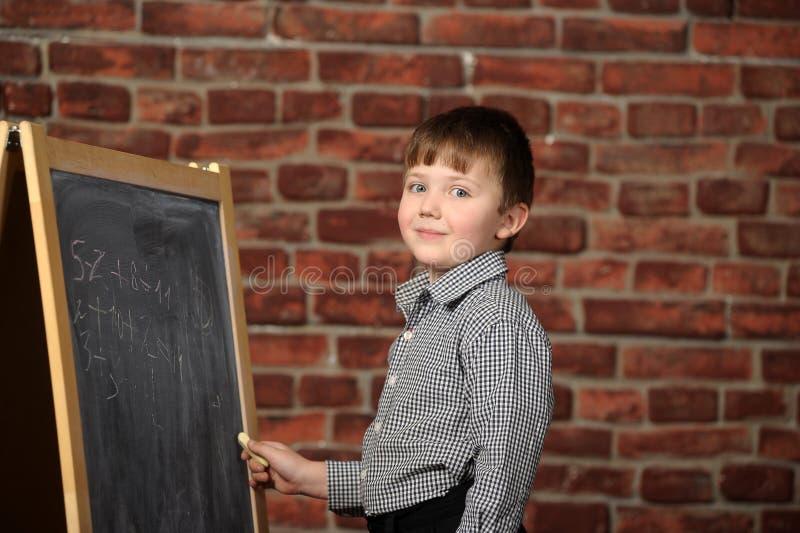 Download Junge an der Tafel stockfoto. Bild von radiergummi, mann - 27732126