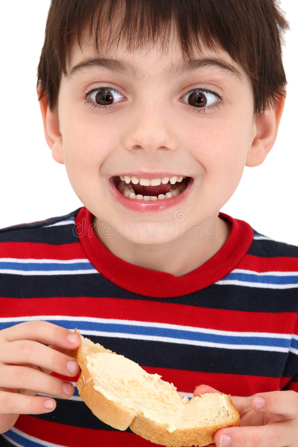 Junge, der Toast isst lizenzfreies stockfoto