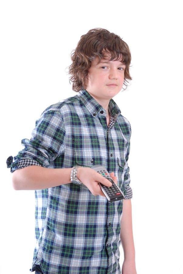 Junge des jungen jugendlich mit Fernsehentfernter station lizenzfreies stockfoto