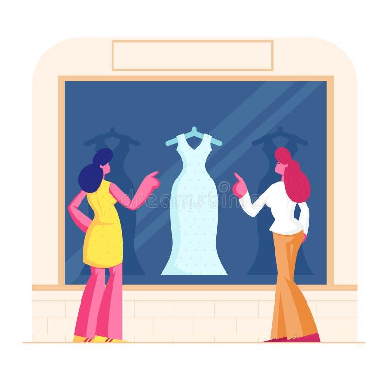 Junge Designerfrauen bei Showcase mit Blick auf modisches Kleid im Store Girls Choose Garment Standing in Apparel stock abbildung