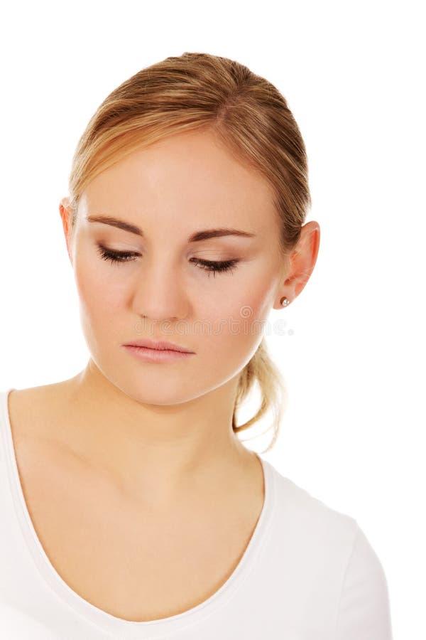 Junge durchdachte und traurige Frau stockfotos