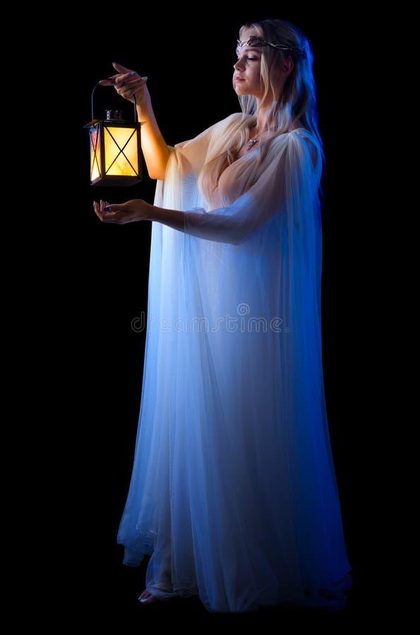 Junge elven Mädchen mit der lokalisierten Laterne stockbilder