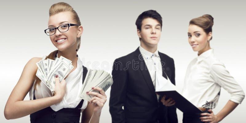 Junge erfolgreiche Geschäftsleute stockfotografie