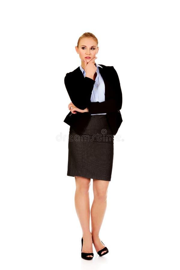 Junge ernste durchdachte Geschäftsfrau stockbild