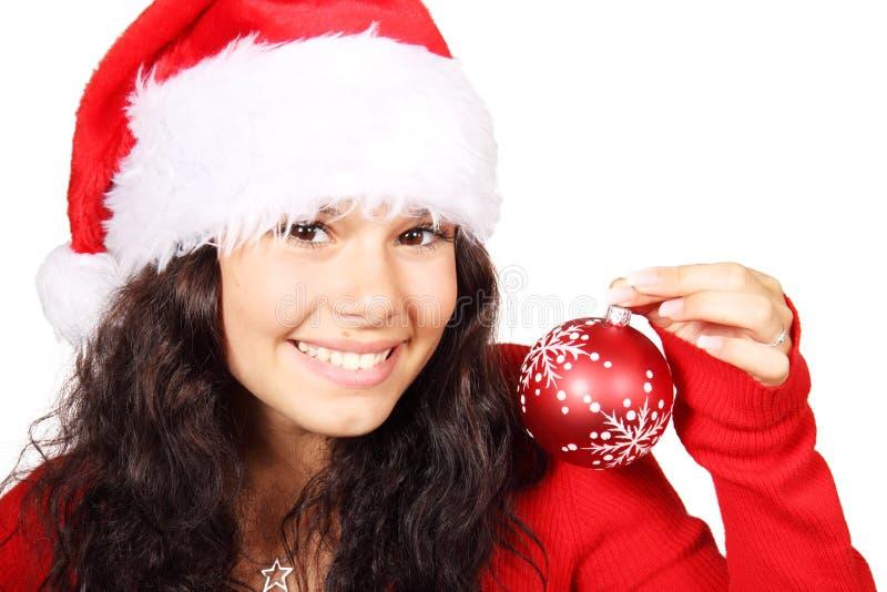 Junge Frau als Sankt mit rotem Weihnachtsflitter stockbild