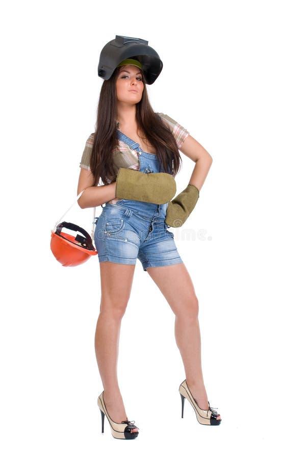Junge Frau in der Schweißerschablone lizenzfreie stockfotos