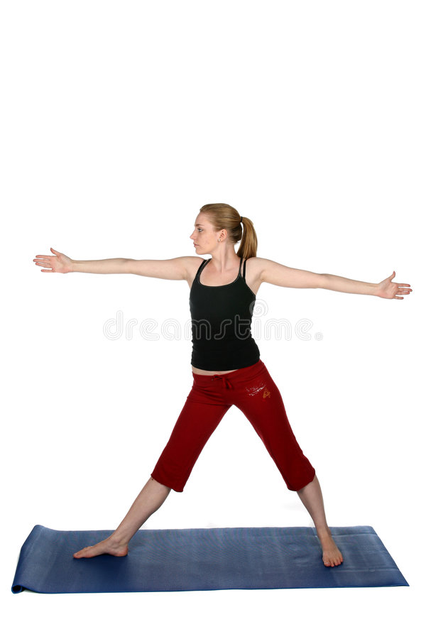 Junge Frau in der stehenden Yogahaltung stockfoto
