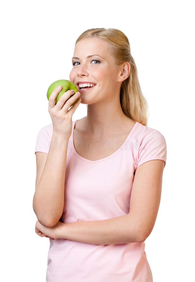Junge Frau, die Apfel isst lizenzfreies stockbild