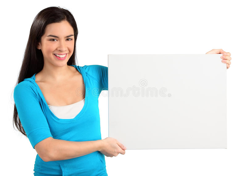 Junge Frau, die ein unbelegtes weißes Zeichen anhält lizenzfreie stockbilder