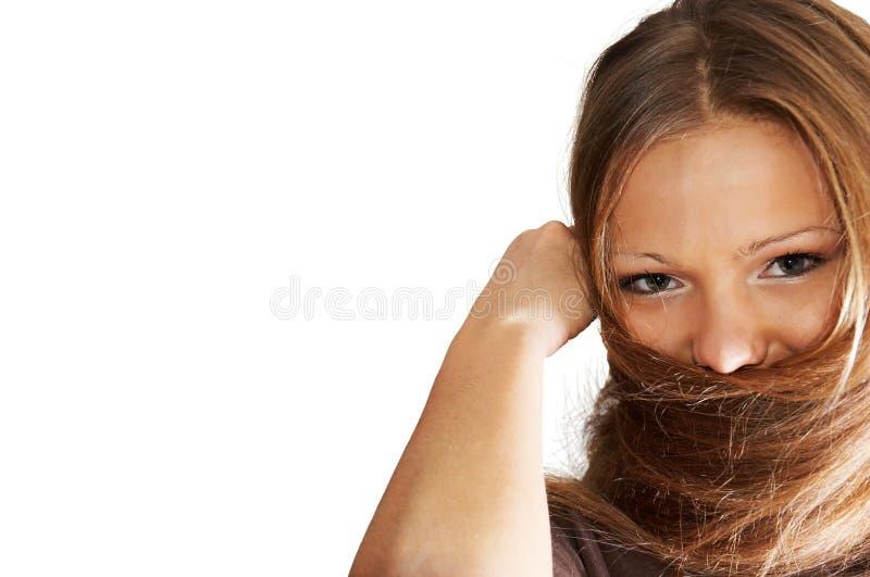 Junge Frau, Die Mit Dem Haar Spielt. Lokalisiert. Stockbilder