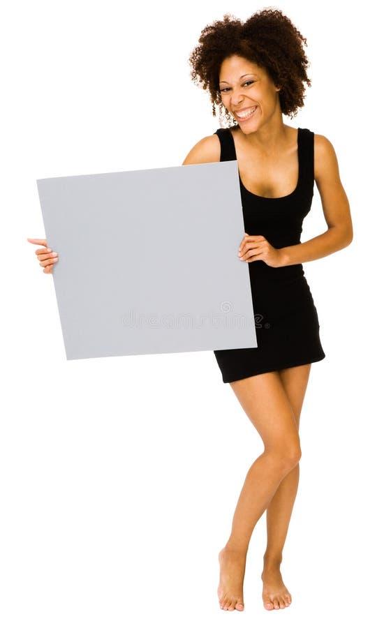 Junge Frau, die Schild zeigt stockfotografie
