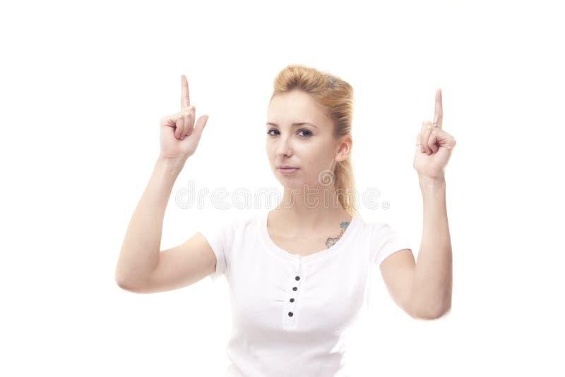 Junge Frau, die sich zeigt stockfotografie