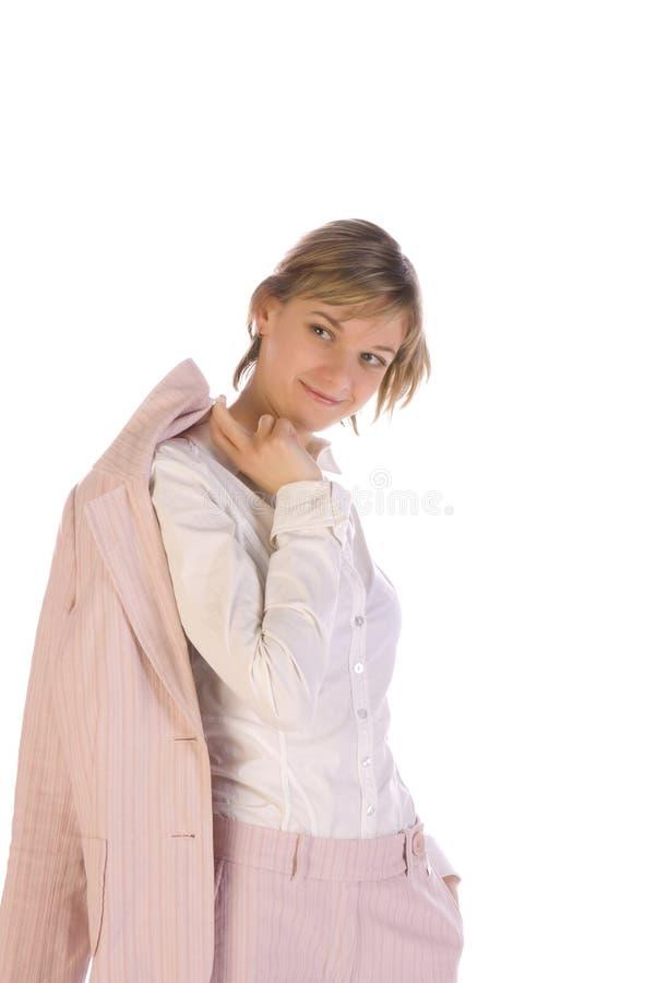 Junge Frau in einem rosafarbenen Anzug lizenzfreie stockbilder