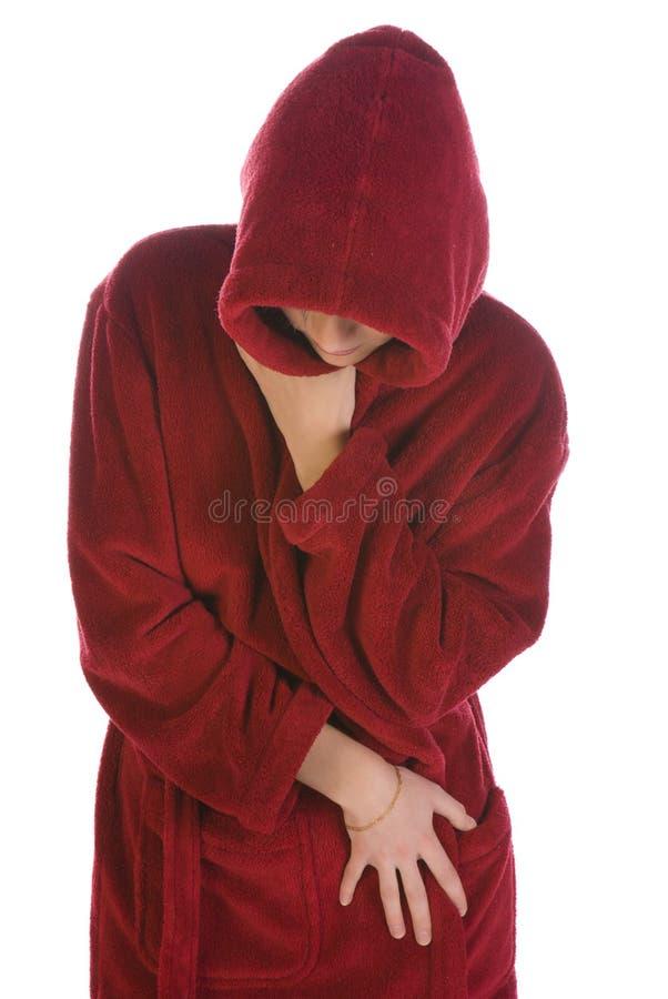 Junge Frau in einer roten Robe lizenzfreies stockbild